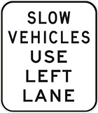 white sign with black text, slow vehicles use left lane