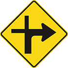 yellow diamond-shaped sign with black arrow that curves sharply right with a thinner line continuing upward and another branching to the left