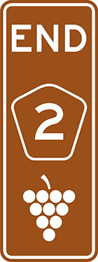 brown sign with the word end, a pentagonal route number badge and grapes icon