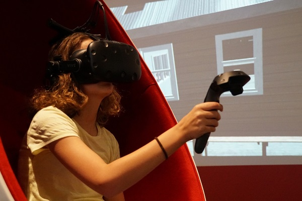 Young girl sitting with Virtual reality equipment.