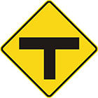 yellow diamond-shaped sign with black T shape