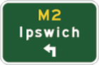green sign with yellow M2, white arrow pointing up and left from the bottom and the word Ipswich