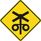 yellow diamond-shaped sign with black icon of a railway crossing sign and with 2 flashing lights