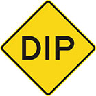 yellow diamond-shaped sign with the word dip in black