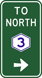 green sign with white arrow and the words to north, as well as a white hexagonal badge with a blue number 3