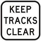 white sign with black text, keep tracks clear