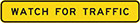 narrow yellow sign with black text, watch for traffic