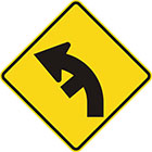 yellow diamond-shaped sign with black arrow that curves steadily left with a line branching off on the inside of the curve
