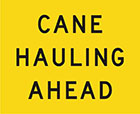 yellow sign with black text, cane hauling ahead