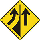 yellow diamond-shaped sign with a black arrow entering from the left and curving upward and another pointing upward with a divider between them