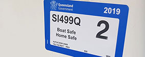 A registration label on a boat
