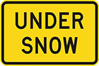 yellow sign with black text, under snow