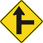 yellow diamond-shaped sign with straight black arrow with a straight branch leaving it at a right angle on the right