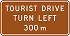 brown sign with white text, tourist drive turn left 300m