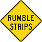 yellow diamond-shaped sign with black text, rumble strips