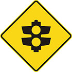 yellow diamond-shaped sign with black icon of traffic lights with only 2 lamps