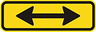 yellow sign with a horizontal black double-ended arrow