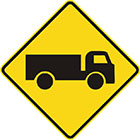 yellow diamond-shaped sign with black truck icon