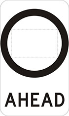 white sign with black circle with space inside for a number, underneath is the word ahead in black