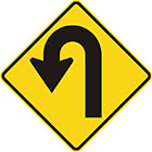 yellow diamond-shaped sign with black arrow that turns left into a u-shape