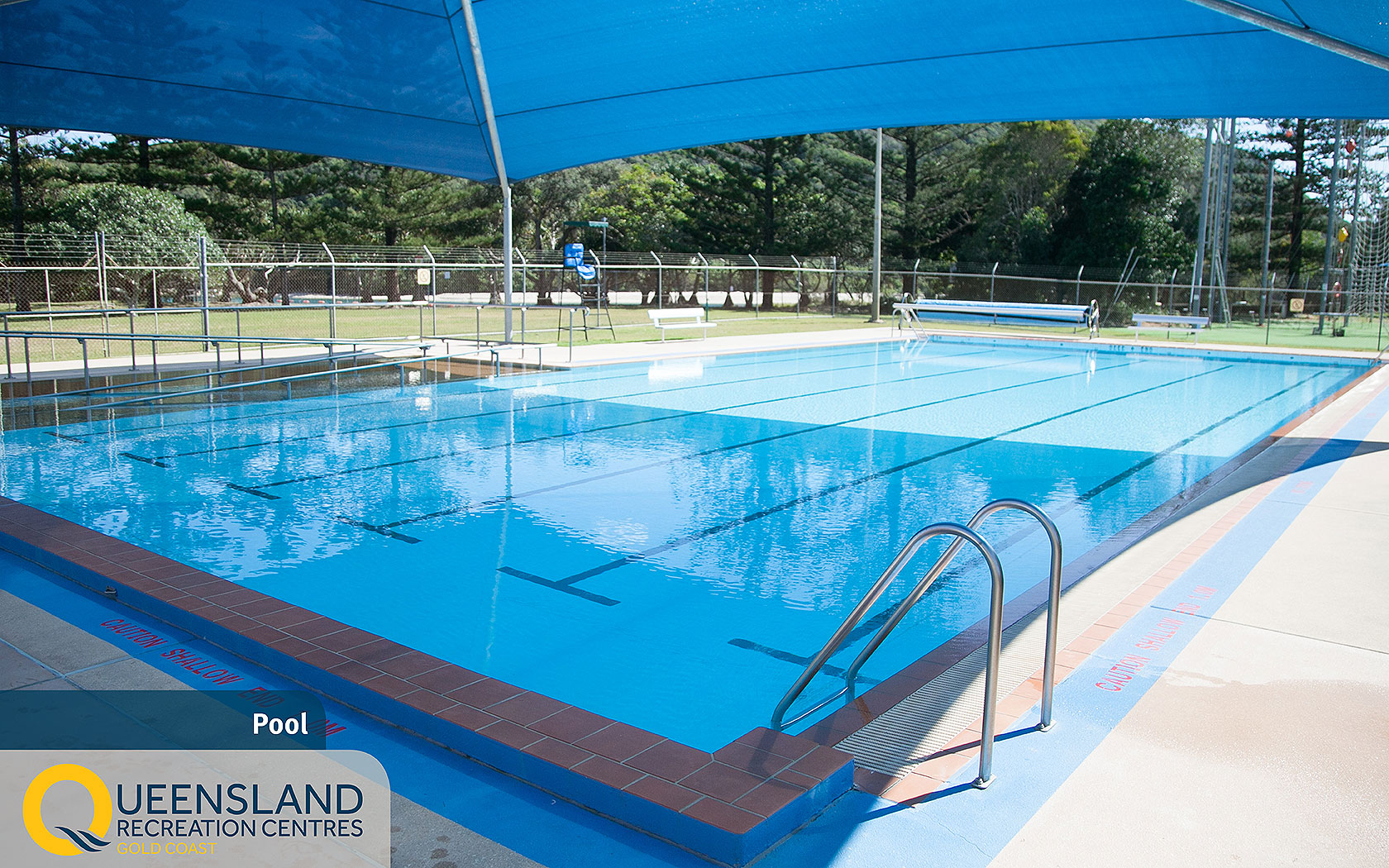 Heated outdoor pool with accessible ramp and shade cloth at the Gold Coast Recreation Centre