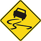 yellow diamond-shaped sign with black car icon and skid marks indicating swerving movement
