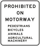 white sign with black text, prohibited on motorway, pedestrians, bicycles, animals, agricultural machinery