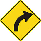 yellow diamond-shaped sign with black arrow that curves steadily to the right
