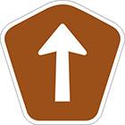 brown pentagonal sign with arrow