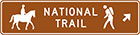 brown sign with icons of a person on a horse and a person hiking with the words national trail