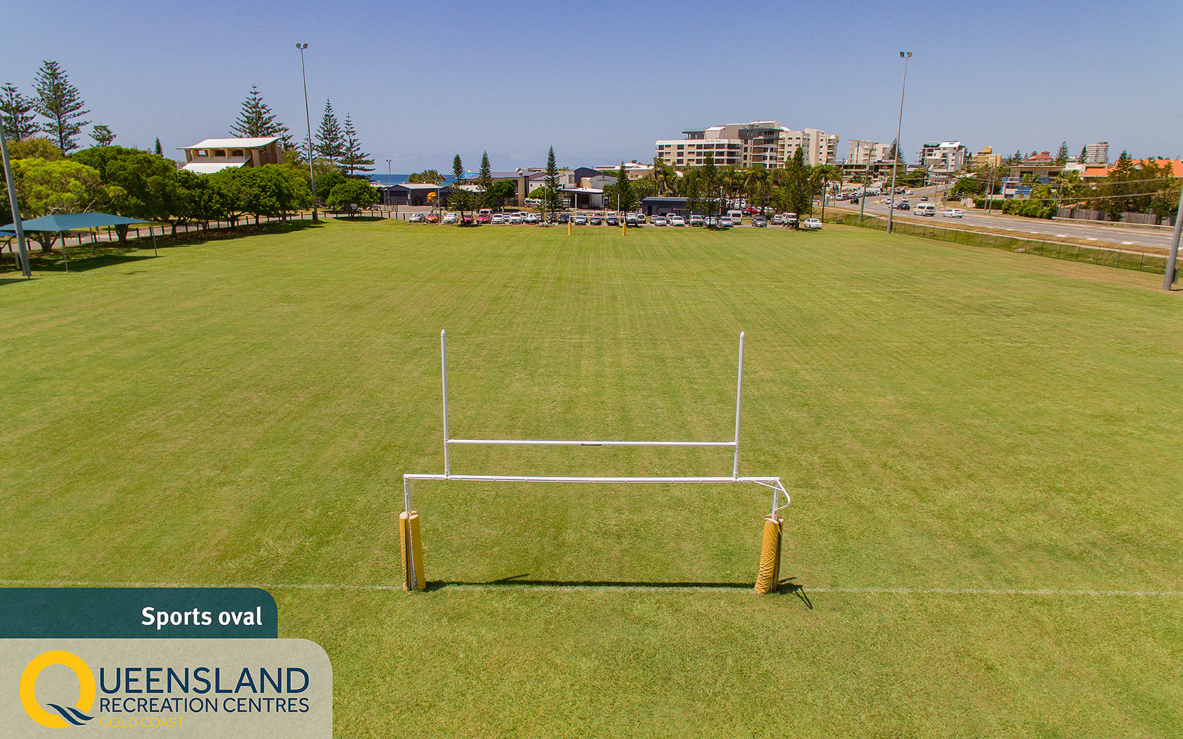 Wide grassy sporting oval with padded goal posts at the Gold Coast Recreation Centre