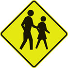yellow diamond-shaped sign with a black symbol of an adult and child walking