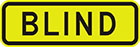 yellow sign with black text, blind