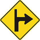 yellow diamond-shaped sign with black arrow that curves sharply right with a thinner line continuing upward