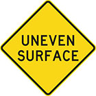 yellow diamond-shaped sign with black text, uneven surface
