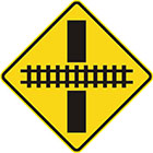 yellow diamond-shaped sign with black line and rail tracks showing what angle they intersect the road