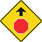 yellow diamond-shaped sign with black arrow and red octagon