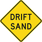yellow diamond-shaped sign with black text, drift sand