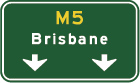 green sign with yellow M5 and white arrows pointing down at the bottom and the word Brisbane