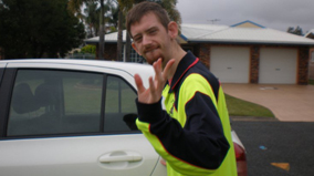 Ryan Boles in his uniform for Bolzy's Go4 Services in Mackay.