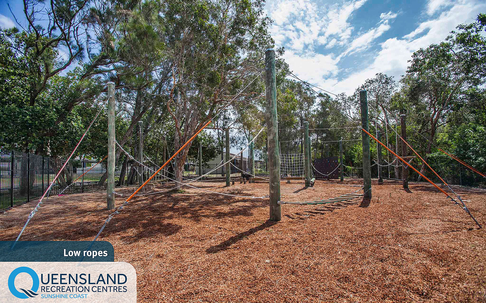 Low hanging ropes, logs and climbing obstacles in bushland at the Sunshine Coast Recreation Centre