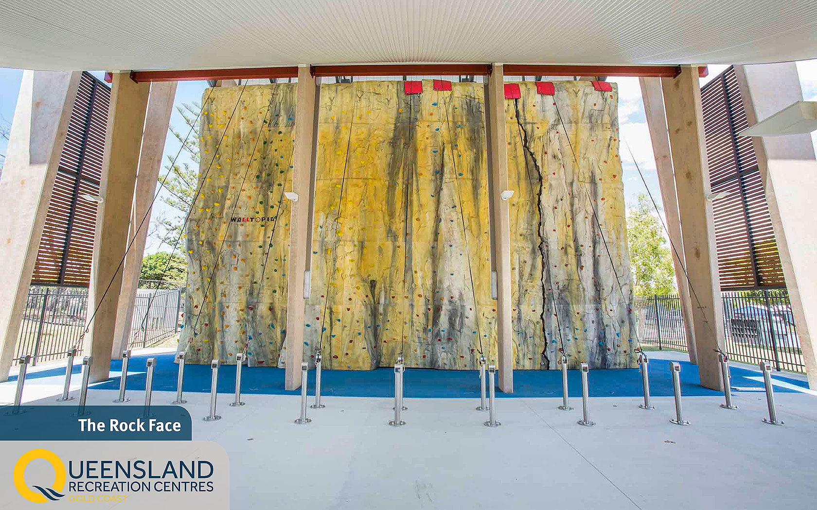 Ten meter high covered rock climbing wall with colourful climbing paths at the Gold Coast Recreation Centre