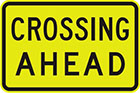 yellow sign with black text, crossing ahead