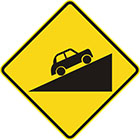 yellow diamond-shaped sign with black car facing up a slope