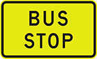 yellow sign with black text, bus stop