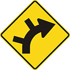 yellow diamond-shaped sign with black arrow that curves steadily right with 2 lines branching off the outside of the curv