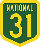 Green shield-shaped sign with yellow text, national 31