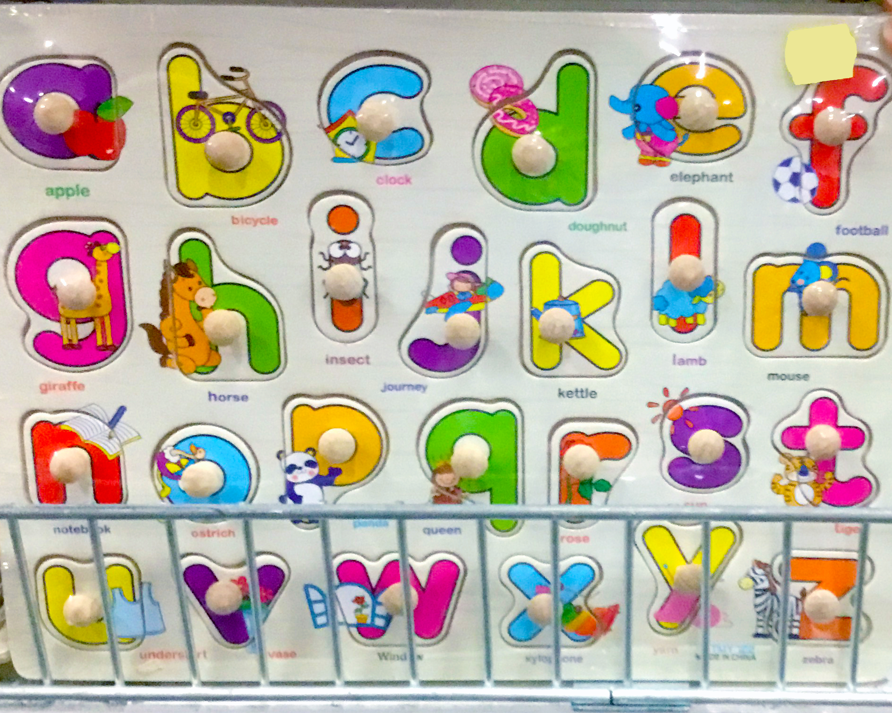 Wooden puzzle with alphabet