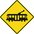 yellow diamond-shaped sign with black tram icon