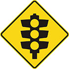 yellow diamond-shaped sign with black traffic lights icon